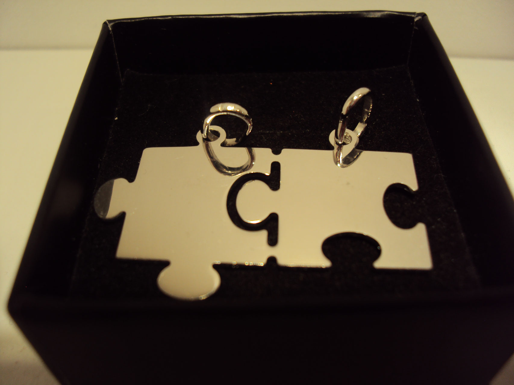 Colgante de puzzle de plata 30€