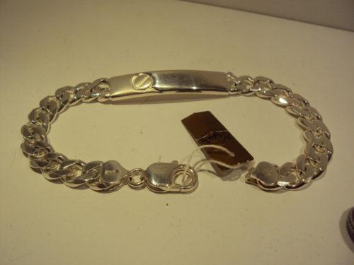 Nomeolvides de plata con placa adorno círculo. 85€