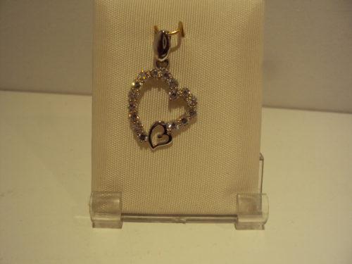 Colgante oro blanco con circonitas con corazón pequeño sin piedras 135e