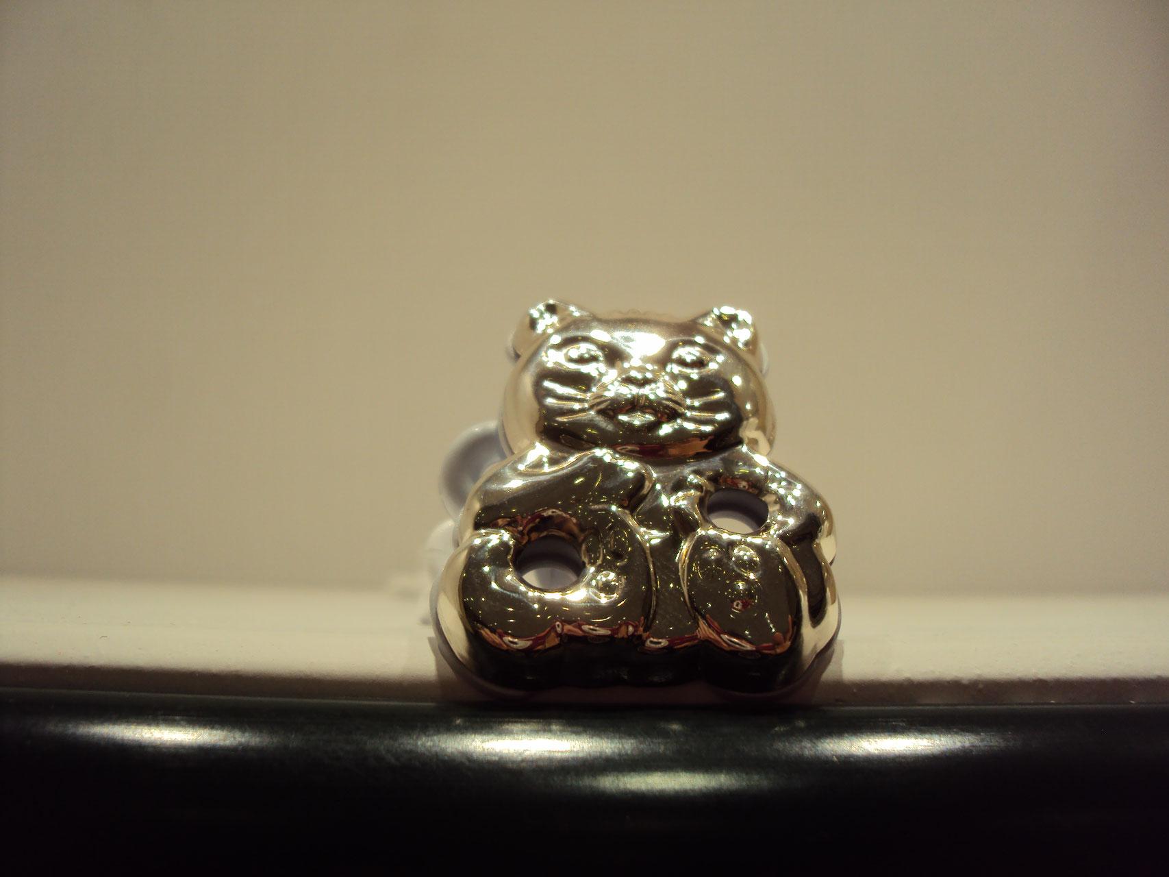 Chupetero de plata con un gato 30€