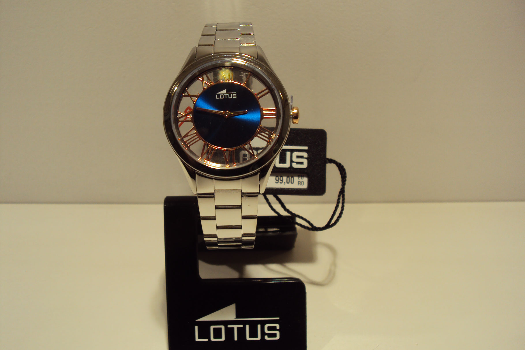 Reloj mujer Lotus fondo transparente,azul eléctrico y cobrizo.99€