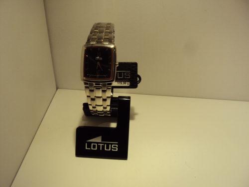 Reloj Lotus de mujer muy planito con fondo oscuro y cobrizo.119€
