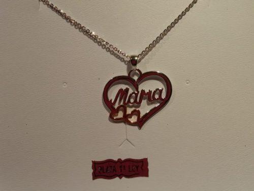 Colgante de plata Lotus con dos corazones cobrizos Colgante de plata Lotus con dos corazones cobrizos y mensaje de mamá. Su precio es de 39€
