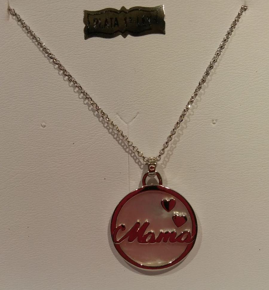 Colgante de plata Lotus redondo de mamá nacarado Colgante de plata Lotus redondo de mamá nacarado con dos corazones. Su precio es de 39€